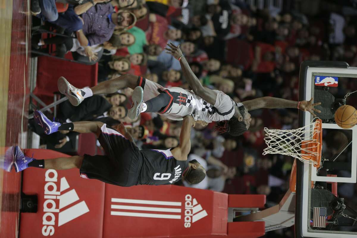 Houston Rockets center Nene Hilario (42) puts up two points and is fouled by LA Clippers guard Alan Anderson (9) in the second half of game action on Friday, Dec. 30, 2016, in Houston. Rockets won the game 140-116.( Elizabeth Conley / Houston Chronicle )