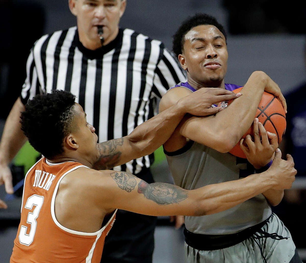 Texas' Jacob Young (3) tries to steal the ball from Kansas State's Kamau Stokes during the second half of an NCAA college basketball game Friday, Dec. 30, 2016, in Manhattan, Kan. Kansas State won 65-62. (AP Photo/Charlie Riedel)