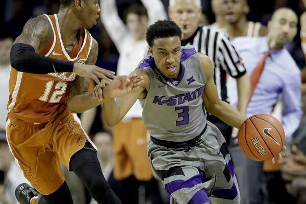 Kansas State's Kamau Stokes (3) is pressured by Texas' Kerwin Roach Jr. (12) during the second half of an NCAA college basketball game Friday, Dec. 30, 2016, in Manhattan, Kan. Kansas State won 65-62. (AP Photo/Charlie Riedel)