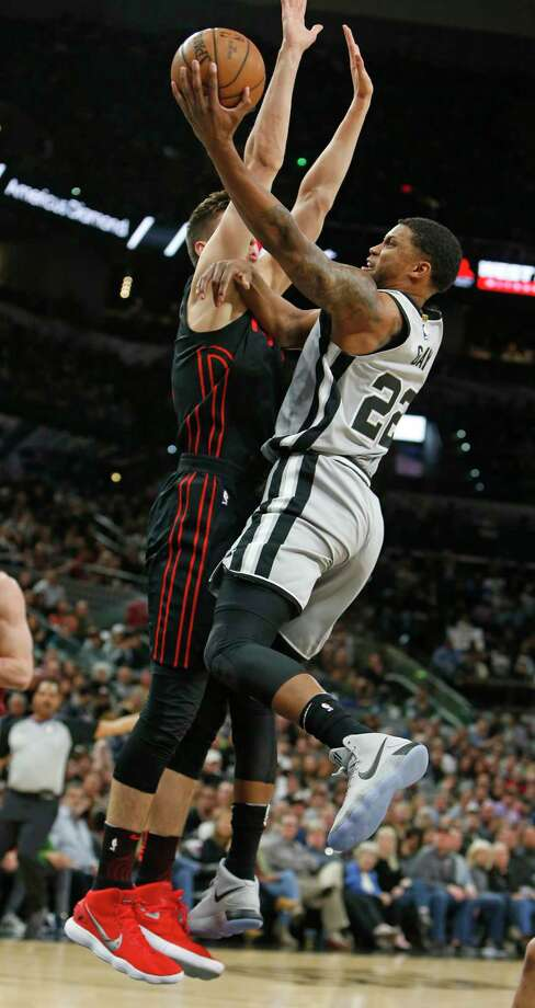 San Antonio Spurs forward Rudy Gay (22) shoots against Portland Trail Blazers center Zach Collins during the first half of an NBA basketball game Saturday, April 7, 2018, in San Antonio. (AP Photo/Ronald Cortes) Photo: Ronald Cortes, Associated Press / Copyright Michael Masters All rights reserved