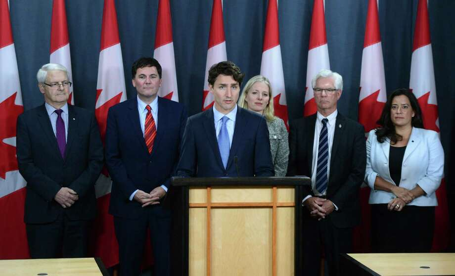 Canada's Prime Minister Justin Trudeau, center, holds a press conference at the National Press Theatre in Ottawa, Ontario, on Tuesday, Nov. 29, 2016. Trudeau has approved one controversial pipeline from the Alberta oil sands to the Pacific Coast, but rejected another. On Tuesday, he approved Kinder Morgan's Trans Mountain pipeline to Burnaby, British Columbia, but rejected Enbridge's Northern Gateway pipeline to Kitimat, B.C.  (Sean Kilpatrick/The Canadian Press via AP) Photo: Sean Kilpatrick, SUB / The Canadian Press