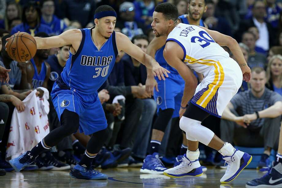 66903156133 Dallas Mavericks guard Seth Curry (30) dribbles against Golden State  Warriors guard Stephen Curry