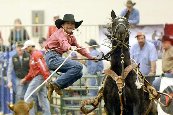 Cayden McFadden of Odessa competes in the Tall City Ultimate New Year's Eve calf roping Saturday, Dec. 31, 2016, at Horseshoe Arena.  James Durbin/Reporter-Telegram