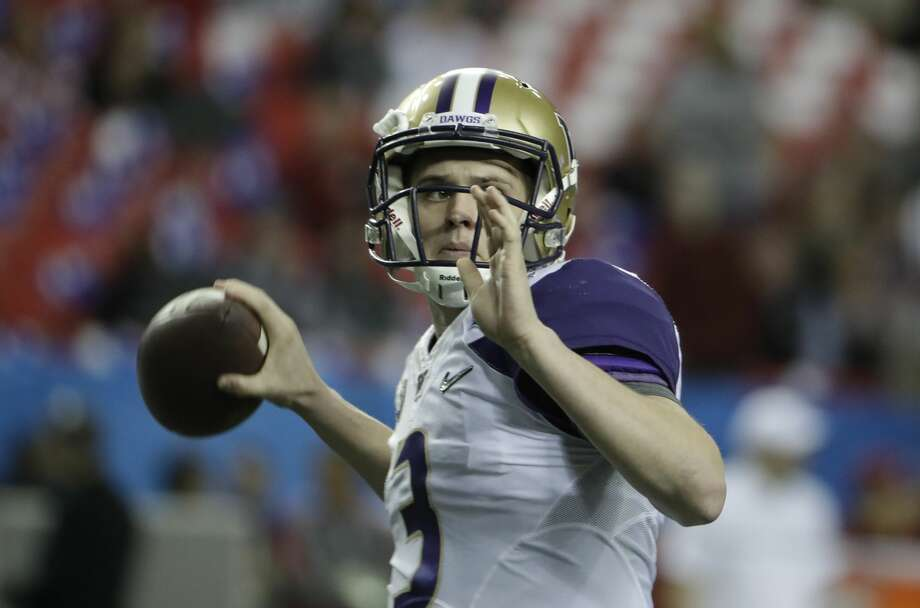 Washington quarterback Jake Browning (3) warms up before the first half of the Peach Bowl NCAA college football playoff game between Alabama and Washington, Saturday, Dec. 31, 2016, in Atlanta. (AP Photo/David Goldman) Photo: David Goldman/AP