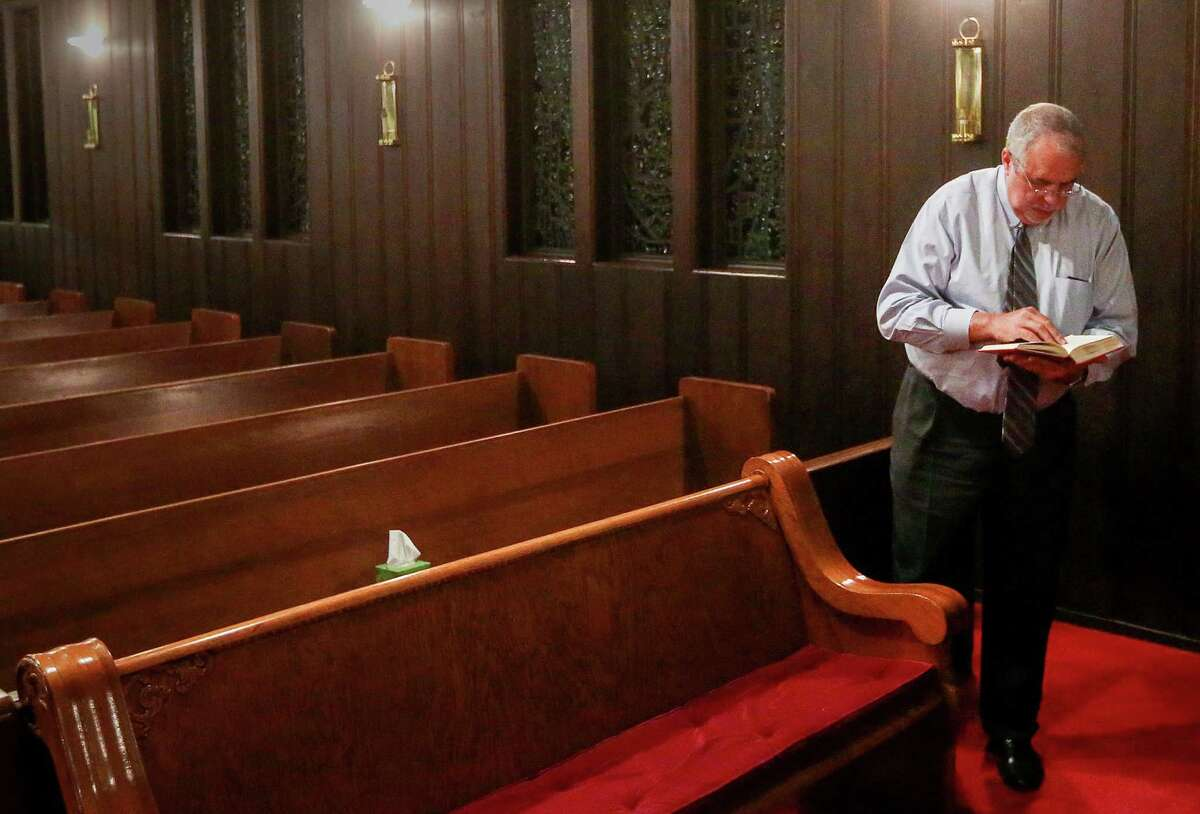 Keith Giblin, a magistrate judge and Episcopal priest, prepares for a service at St. Paul's Episcopal Church Wednesday, Dec. 14, 2016, in Orange. Giblin went to seminary, commuting each weekend for three years, to become a priest in mid-life. ( Jon Shapley / Houston Chronicle )