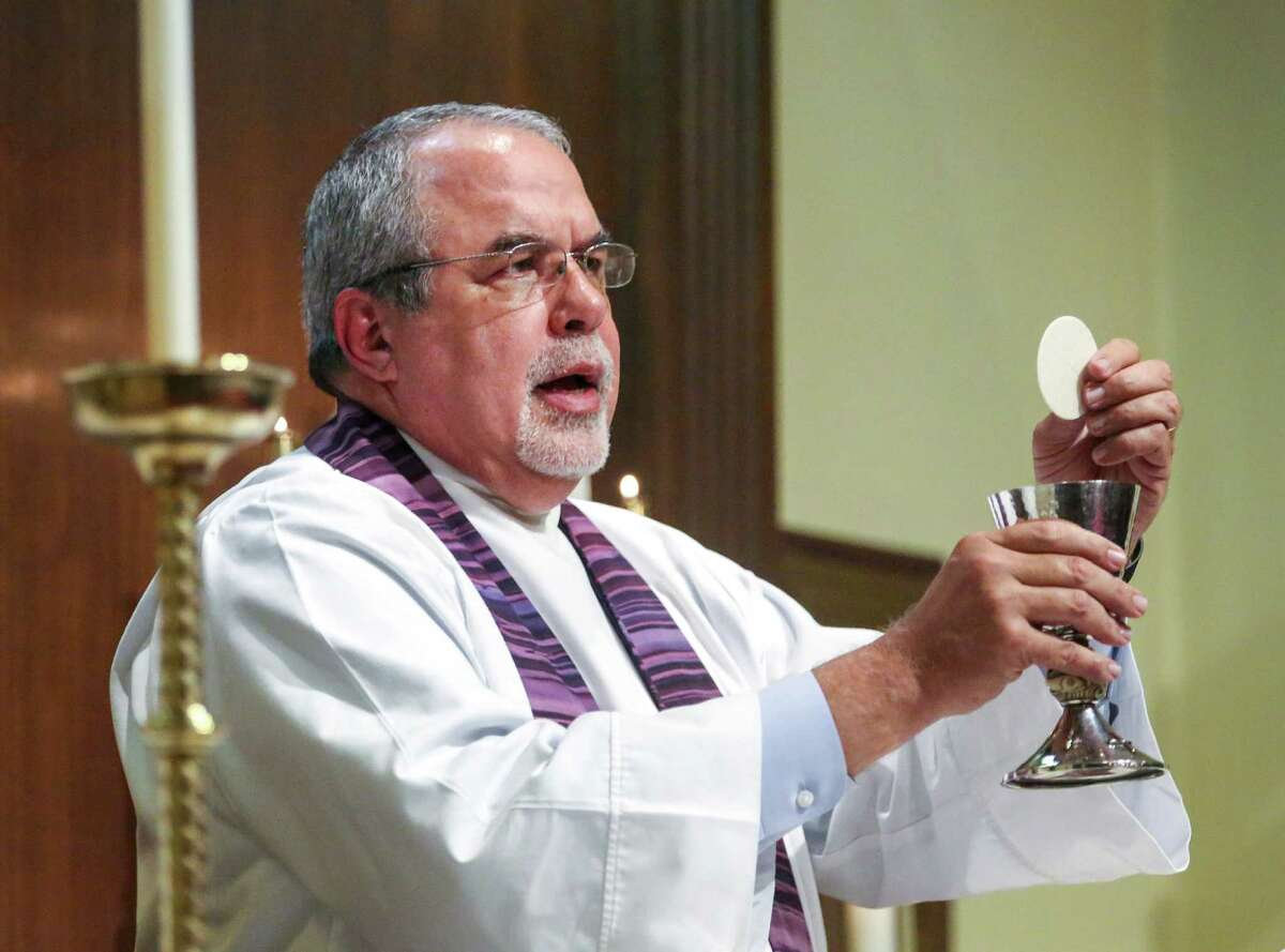 Keith Giblin, a magistrate judge and Episcopal priest, prepares communion during a service at St. Paul's Episcopal Church Wednesday, Dec. 14, 2016, in Orange. Giblin went to seminary, commuting each weekend for three years, to become a priest in mid-life. ( Jon Shapley / Houston Chronicle )