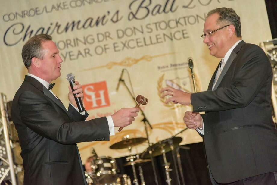 Dr. Don Stockton, left, hands the gavel to Hector Forestier to take over as the 2016 chairman of the board at the annual Conroe/Lake Conroe Area Chairman's Ball. Forestier is being honored Jan. 21 for his service as chairman. Tickets and tables are still available. Photo: Submitted
