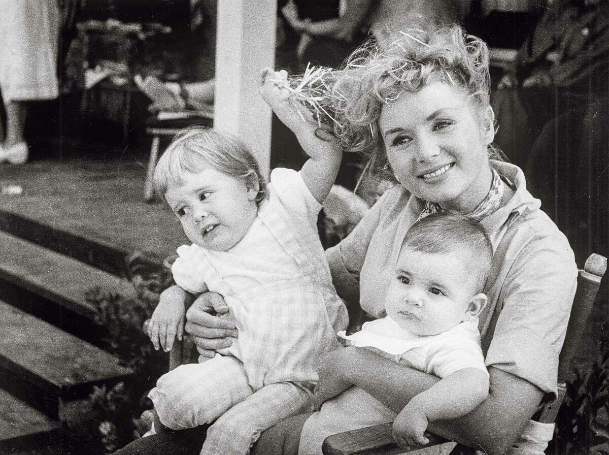 Debbie Reynolds, the beloved movie queen who held her head high under very public marital scandal, with little ones Carrie and Todd Fisher.