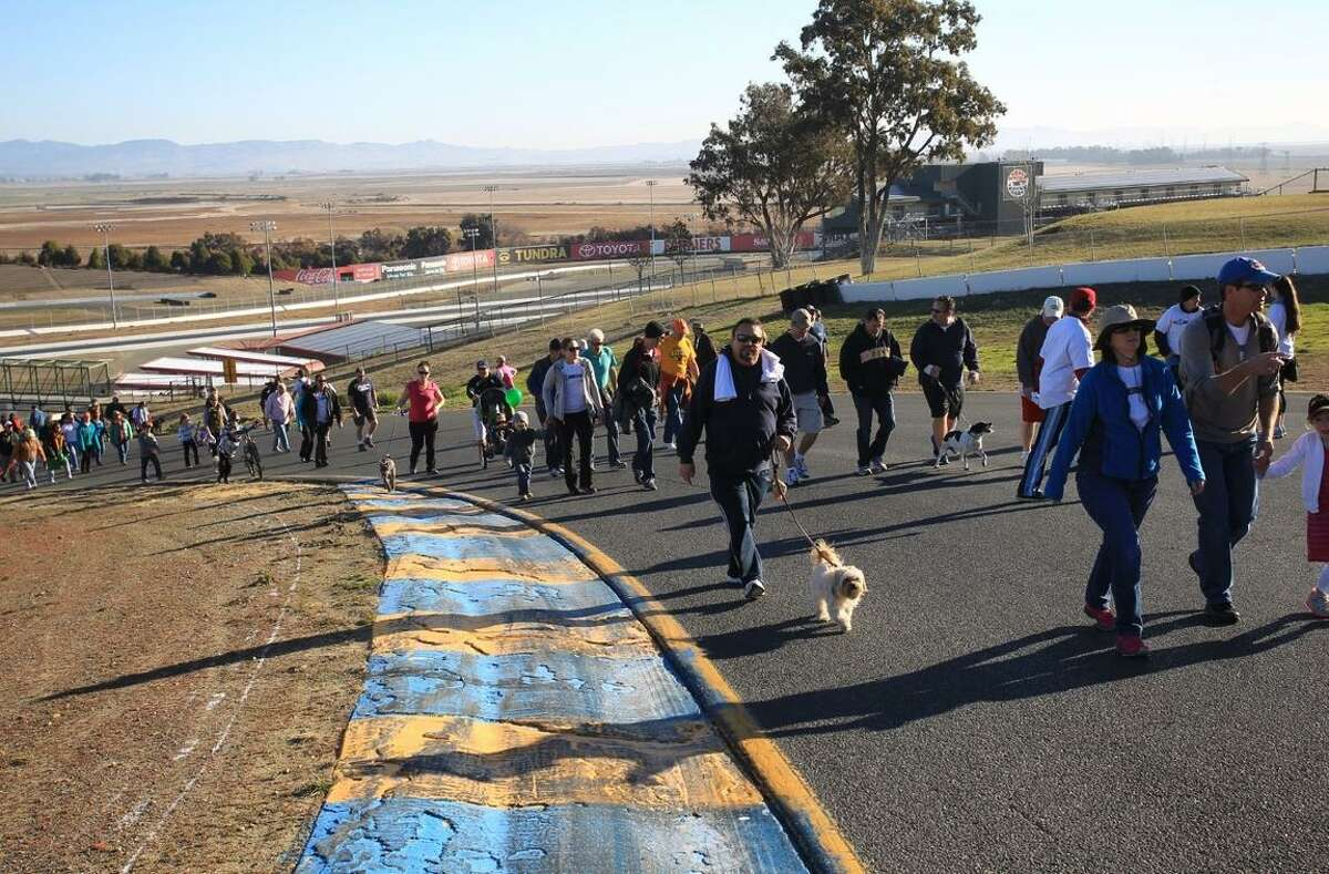 Participants take Turn 2 at the Sonoma Raceway road course in Sonoma during John's March Against Cancer to benefit stomach cancer research.