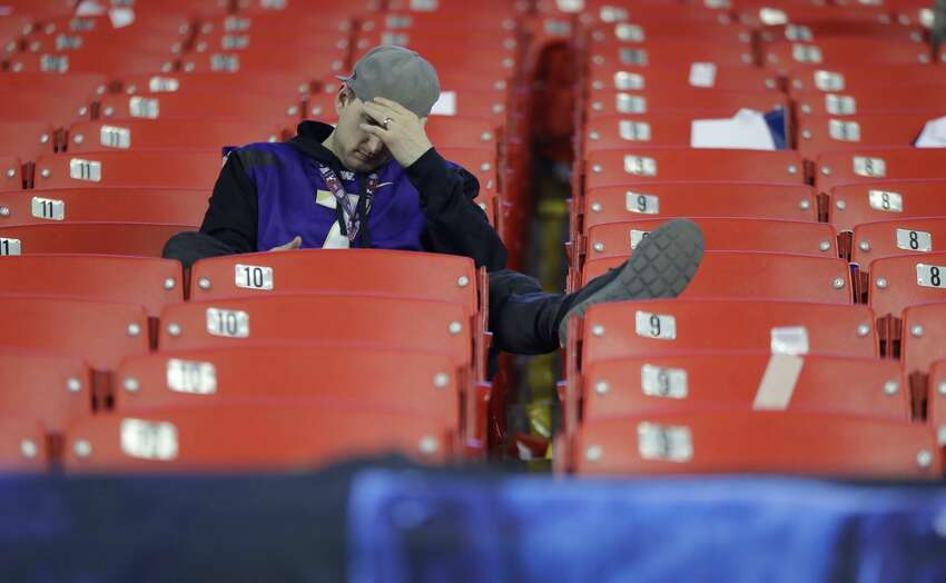 A Washington fan sits in the stands after the Peach Bowl NCAA college football playoff game between Alabama and Washington, Saturday, Dec. 31, 2016, in Atlanta. Alabama won 24-7. (AP Photo/David Goldman)
