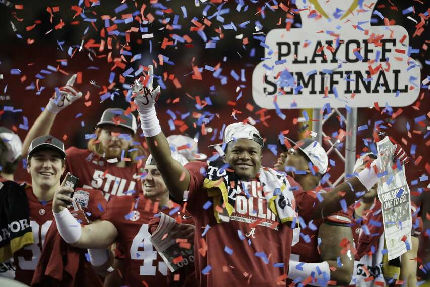 Alabama players celebrate after the Peach Bowl NCAA college football playoff game between Alabama and Washington, Saturday, Dec. 31, 2016, in Atlanta. Alabama won 24-7. (AP Photo/David Goldman)