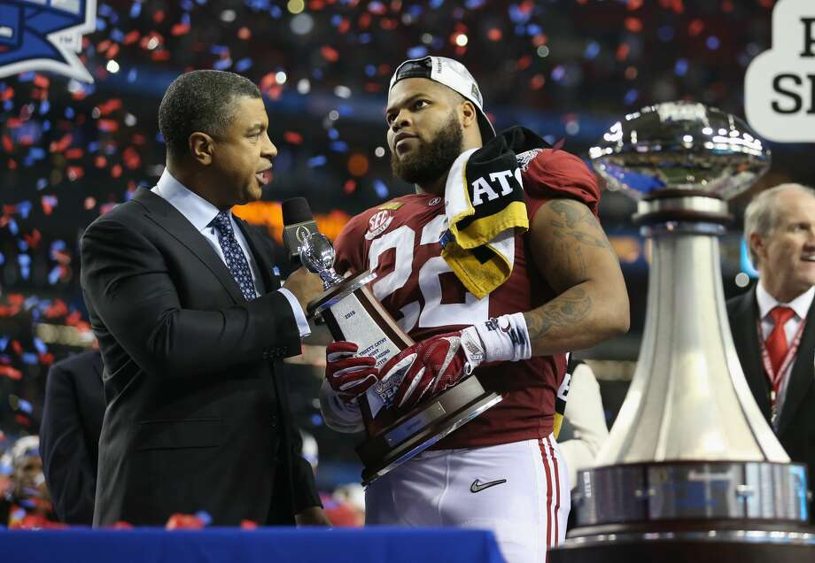 ATLANTA, GA - DECEMBER 31:  Ryan Anderson #22 of the Alabama Crimson Tide recives the deffensive player of the game after winning 24 to 7 against the Washington Huskies during the 2016 Chick-fil-A Peach Bowl at the Georgia Dome on December 31, 2016 in Atlanta, Georgia.  (Photo by Streeter Lecka/Getty Images) Photo: Streeter Lecka/Getty Images