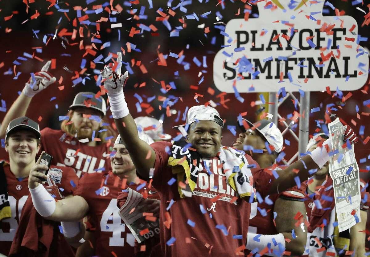 Alabama players celebrate after the Peach Bowl NCAA college football playoff game between Alabama and Washington, Saturday, Dec. 31, 2016, in Atlanta. Alabama won 24-7. (AP Photo/David Goldman)