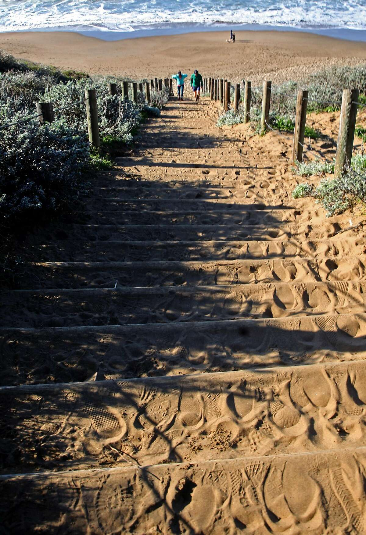 Visitors along the California Coastal Trail climb the Sand Stairs from Baker Beach in San Francisco, California, on Friday December 30, 2016.