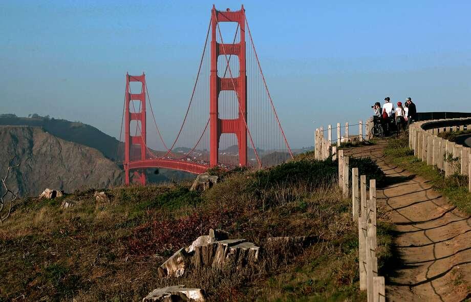 FILE-- Visitors along the California Coastal Trail above the Golden Gate Bridge in San Francisco, California, on Friday Dec. 30, 2016. Photo: Michael Macor, The Chronicle