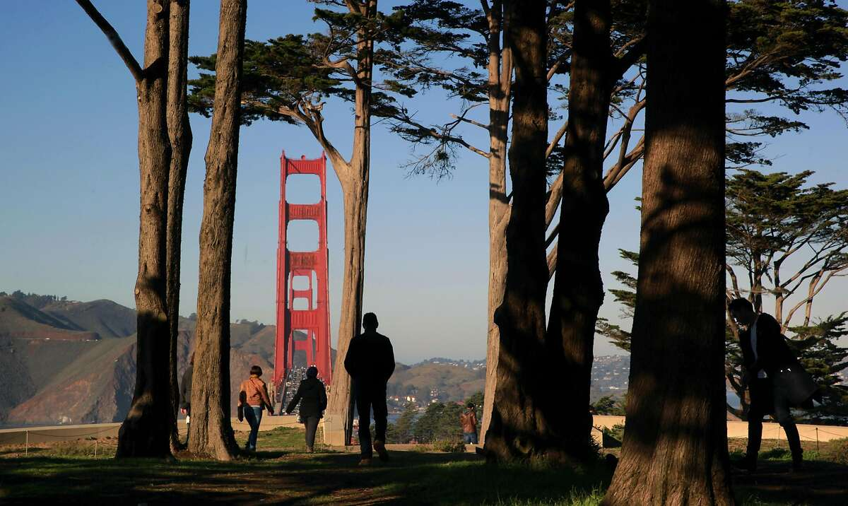 Visitors along the California Coastal Trail above the Golden Gate Bridge in San Francisco, California, on Friday December 30, 2016.