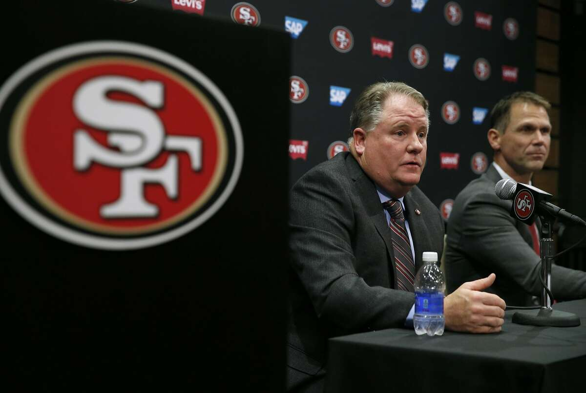 Chip Kelly responds to questions from reporters after he is introduced as the new head coach of the San Francisco 49ers by general manager Trent Baalke (right) at a news conference at Levi's Stadium in Santa Clara, Calif. on Wednesday, Jan. 20, 2016.
