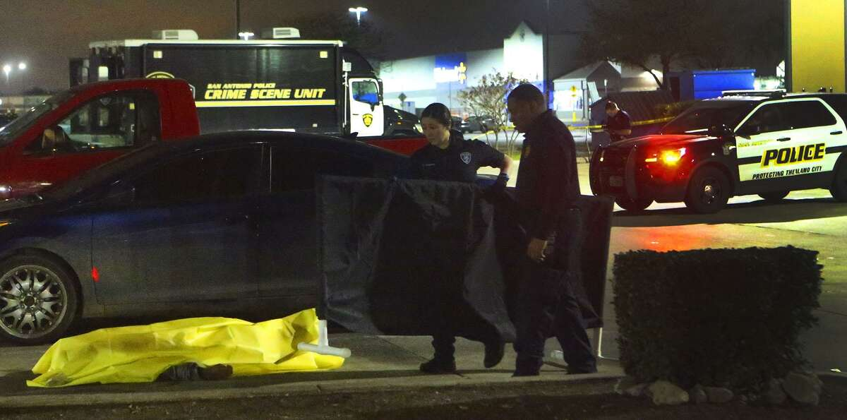 San Antonio Police investigate the death of a person found Wednesday, Dec. 28, 2016 in the parking lot of a Jack In the Box restaurant on Rigsby Avenue on the East Side. The man, later identified as Eddie Carter, was one of the last people murdered in 2016. Over 150 people were killed last year, making it the deadliest year since 1995.