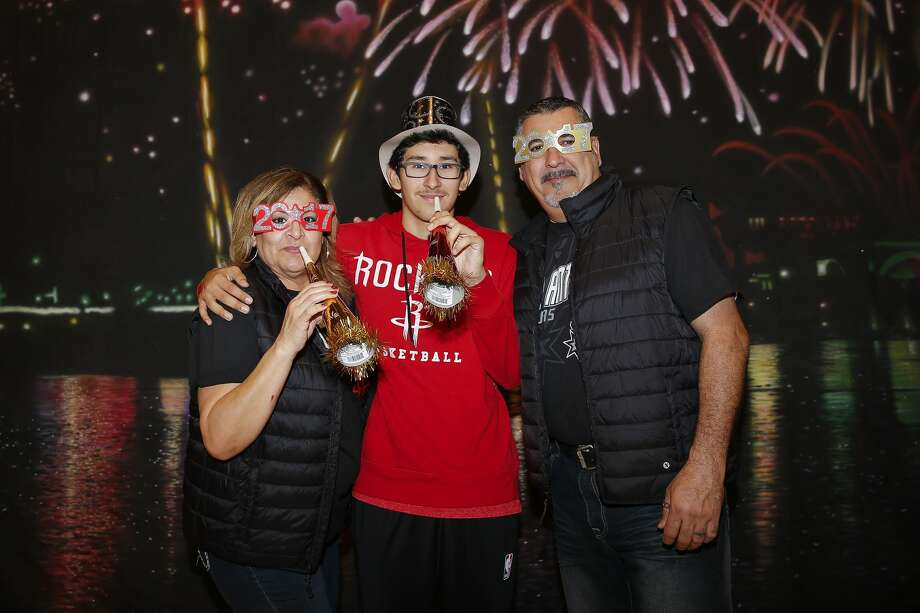 Fans pose for New Year's Eve pictures before the Houston Rockets take on the New York Knicks at the Toyota Center Saturday, Dec. 31, 2016 in Houston. ( Michael Ciaglo / Houston Chronicle ) Photo: Michael Ciaglo/Houston Chronicle