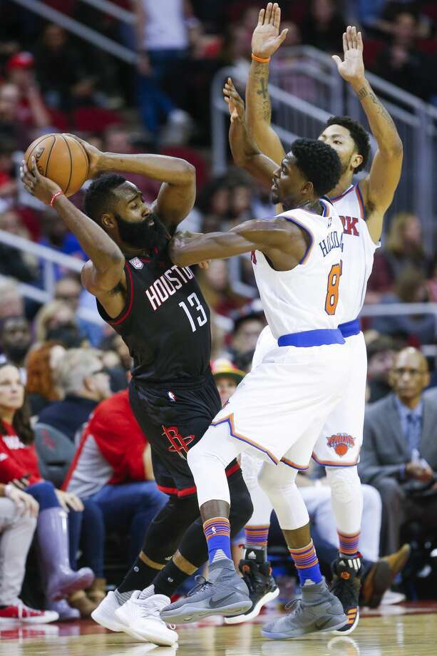 Houston Rockets guard James Harden (13) looks to make a pass around New York Knicks guard Justin Holiday (8) and guard Derrick Rose (25) as the Houston Rockets take on the New York Knicks at the Toyota Center Saturday, Dec. 31, 2016 in Houston. ( Michael Ciaglo / Houston Chronicle ) Photo: Michael Ciaglo/Houston Chronicle