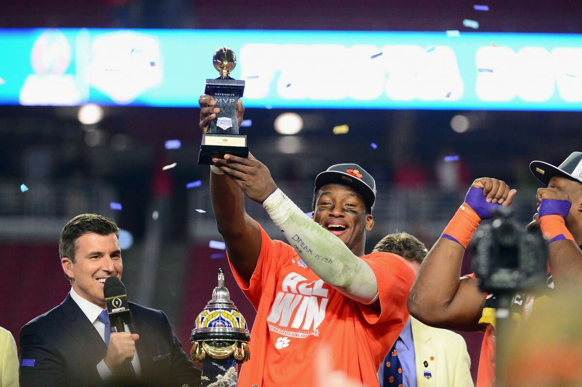 GLENDALE, AZ - DECEMBER 31: Clelin Ferrell #99 of the Clemson Tigers holds the Fiesta Bowl defensive MVP trophy after the Clemson Tigers beat the Ohio State Buckeyes 31-0 to win the 2016 PlayStation Fiesta Bowl at University of Phoenix Stadium on December 31, 2016 in Glendale, Arizona. (Photo by Jennifer Stewart/Getty Images)