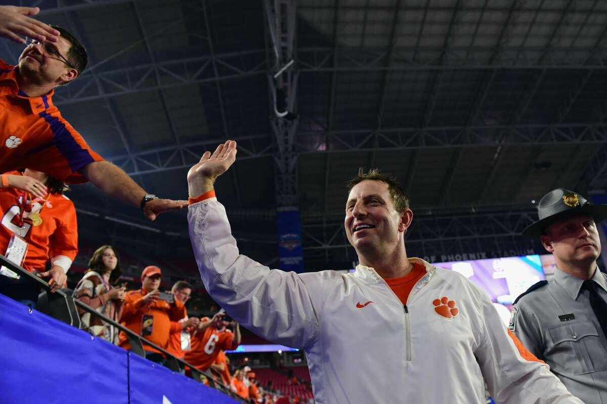 GLENDALE, AZ - DECEMBER 31: Head coach Dabo Swinney of the Clemson Tigers greets fans after the Clemson Tigers beat the Ohio State Buckeyes 31-0 to win the 2016 PlayStation Fiesta Bowl at University of Phoenix Stadium on December 31, 2016 in Glendale, Arizona. (Photo by Jennifer Stewart/Getty Images)