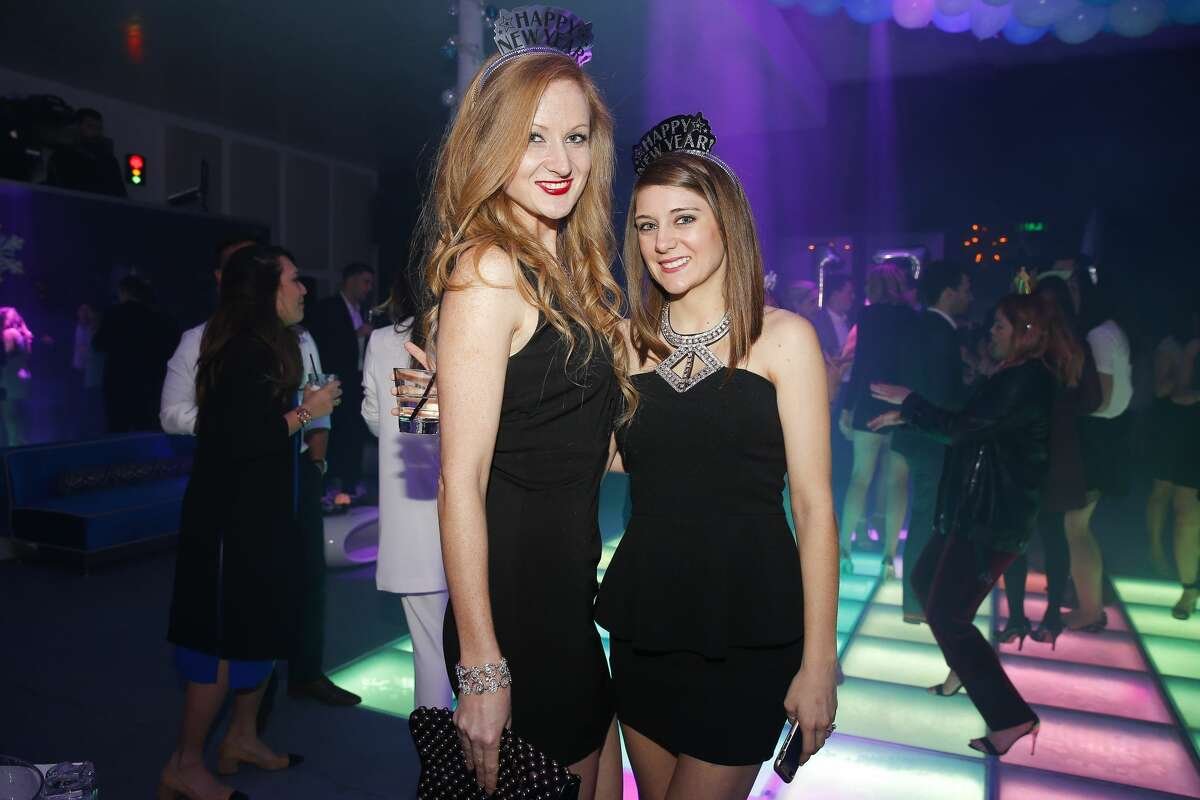 Houstonians know how to party to ring in the New Year. People party at Bar Bleu on New Year's Eve Saturday, Dec. 31, 2016 in Houston. Continue clicking to see the other scenes of Houston's NYE celebrations.