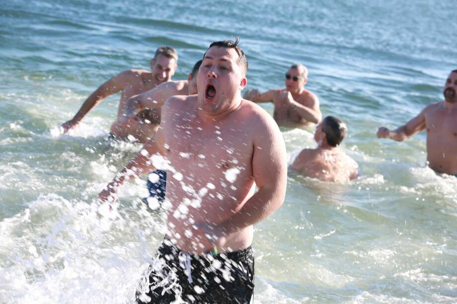 Temple  Israel held its tenth annual Freezin' for a Reason Polar Bear Plunge at  Compo Beach in Westport New Years Day 2017. Brave participants plunged  into the cold Long Island Sound to raise money for local charities and  for the Temple Israel social action funds. Were you SEEN? Photo: Derek Sterling/Hearst CT Media