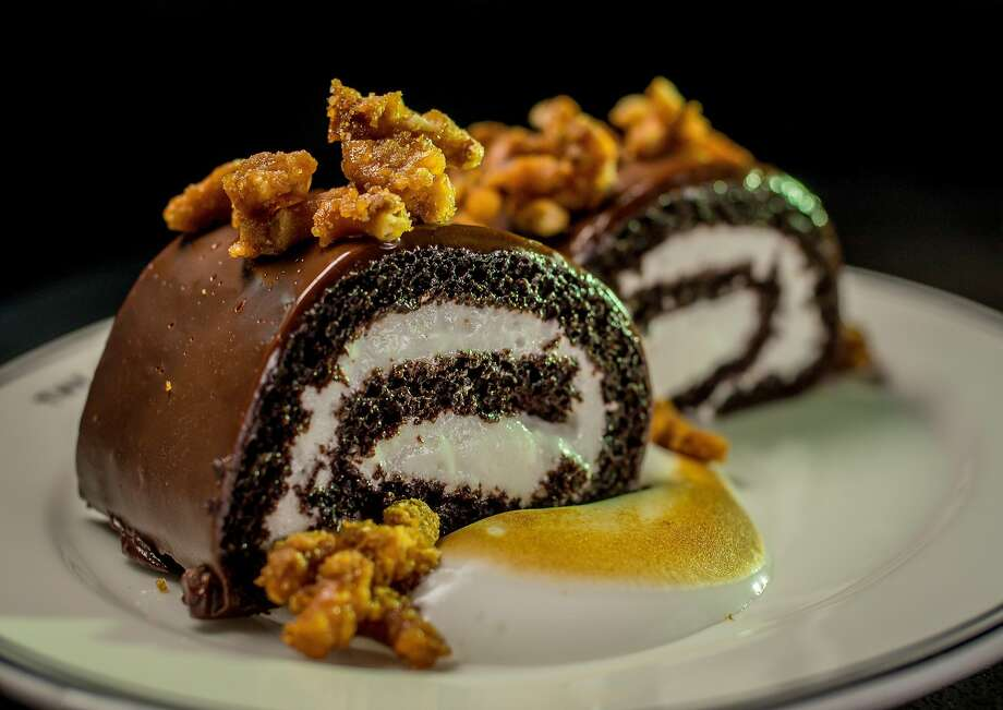 A light-hearted take on the Ho Ho ($9) combines frosted chocolate roulade and vanilla cream at the Saratoga in S.F. Photo: John Storey, Special To The Chronicle