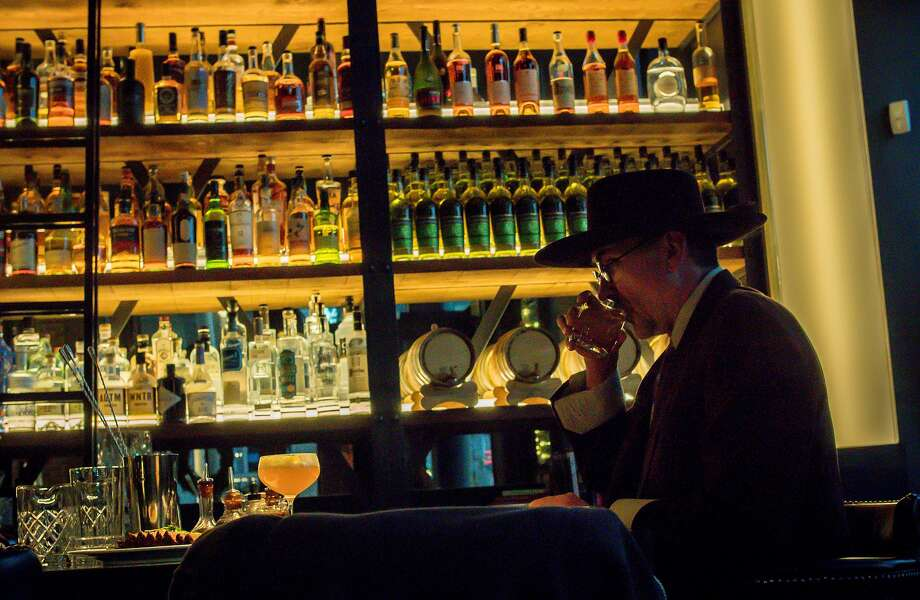 A man has a drink at the bar at the Saratoga in San Francisco, Calif. on December 31st, 2016. Photo: John Storey, Special To The Chronicle