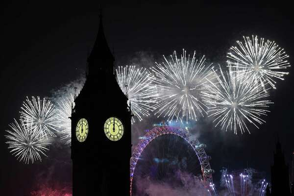 LONDON, ENGLAND - JANUARY 01:  Fireworks light up the London skyline and Big Ben just after midnight on January 1, 2017 in London, England. Thousands of people lined the banks of the River Thames in central London to see in the New Year with a spectacular fireworks display.