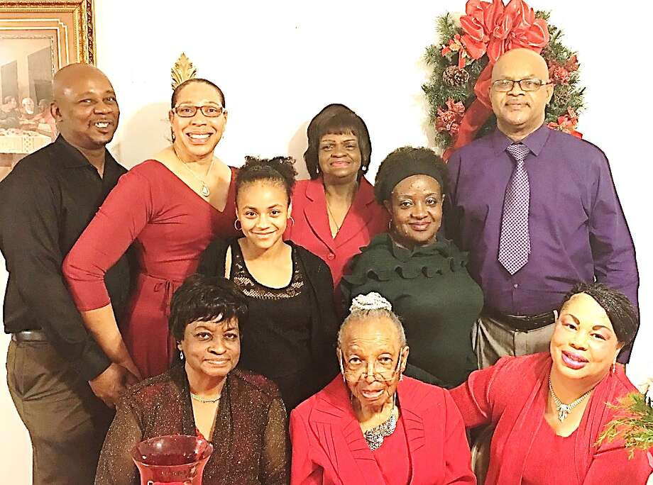 St. Miles Missionary Baptist Church in Ames celebrated its Ushers Annual Christmas Dinner on Dec. 17, 2016.  St. Miles ushers reached out to the community this Christmas year and adopted a child.  Cynthia Grove presented Myah Diaz of Liberty with Christmas Gifts.  Luella Durham (oldest active usher) was also presented with a beautiful bouquet of flowers. Pictured are (seated, left to right) Faye Brooks, Luella Durham, Sharon Guillory; (standing) LV Grove Jr., Cynthia Grove, Ann Stewart, Myah Diaz, Donna Winters and Arthur Baines. Not pictured is Pat Bible. Photo: Submitted