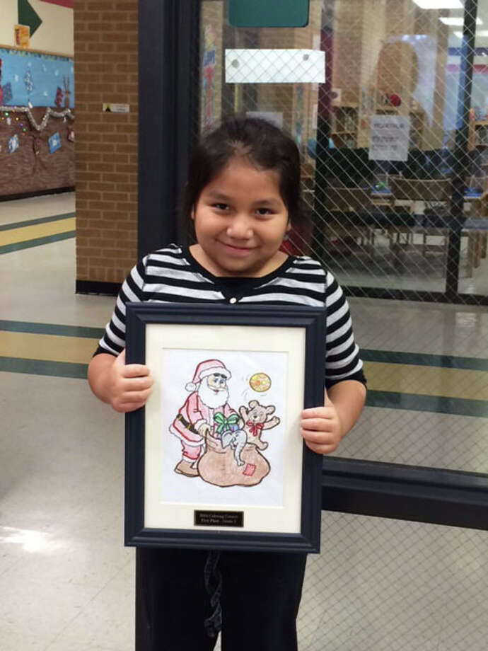 Genisis Lissette Chang, a second-grader at Southside Primary in Cleveland, won first place in her grade division of the Hometown Christmas Coloring Contest. Photo: Submitted