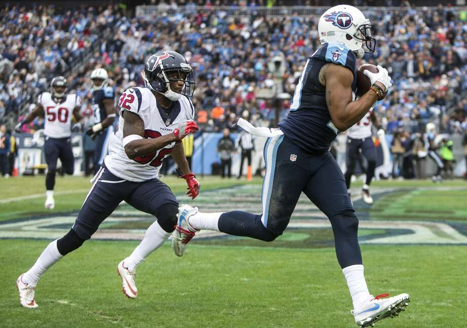 Tennessee Titans wide receiver Rishard Matthews (18) beats Houston Texans defensive back Robert Nelson (32) into the end zone for a 2-yard touchdown reception during the second quarter of an NFL football game at Nissan Stadium on Sunday, Jan. 1, 2017, in Nashville. ( Brett Coomer / Houston Chronicle ) Photo: Brett Coomer/Houston Chronicle