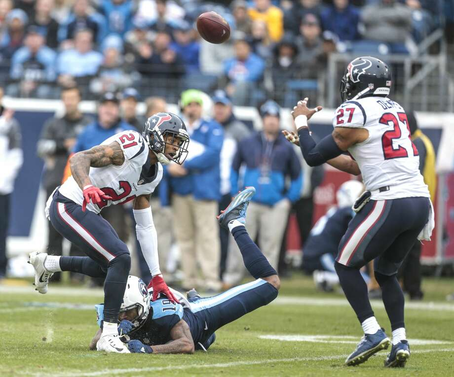 Houston Texans strong safety Quintin Demps (27) intercepts a pass intended for Tennessee Titans wide receiver Tajae Sharpe (19) during the second quarter of an NFL football game at Nissan Stadium on Sunday, Jan. 1, 2017, in Nashville. ( Brett Coomer / Houston Chronicle ) Photo: Brett Coomer/Houston Chronicle