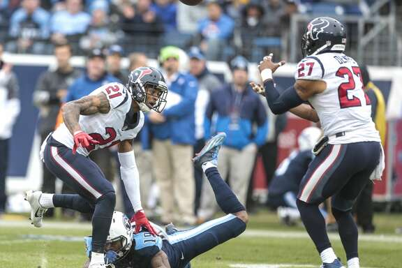 Houston Texans strong safety Quintin Demps (27) intercepts a pass intended for Tennessee Titans wide receiver Tajae Sharpe (19) during the second quarter of an NFL football game at Nissan Stadium on Sunday, Jan. 1, 2017, in Nashville. ( Brett Coomer / Houston Chronicle )
