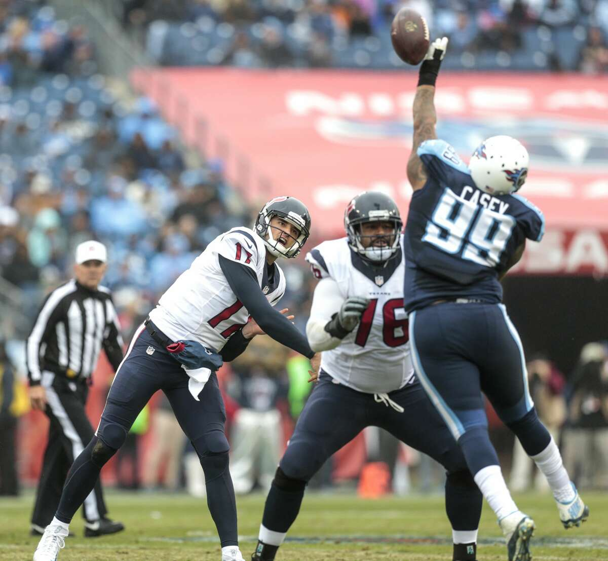 Tennessee Titans defensive end Jurrell Casey (99) knocks down a pass by Houston Texans quarterback Brock Osweiler (17) during the second quarter of an NFL football game at Nissan Stadium on Sunday, Jan. 1, 2017, in Nashville. ( Brett Coomer / Houston Chronicle )