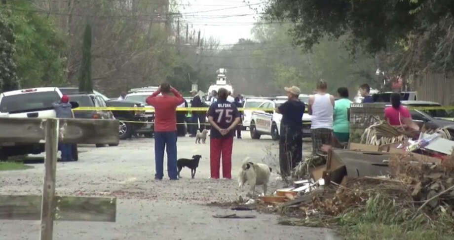 Neighbors crowded around the crime scene after a gun-toting man was shot by a sheriff's deputy. Photo: Metro Video