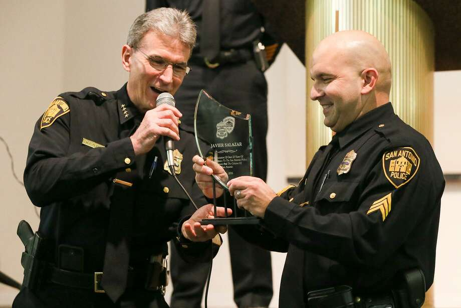 Police Chief William McManus presents Salazar with an award last month for his many years of service to the SAPD. Photo: Marvin Pfeiffer / San Antonio Express-News / Express-News 2016