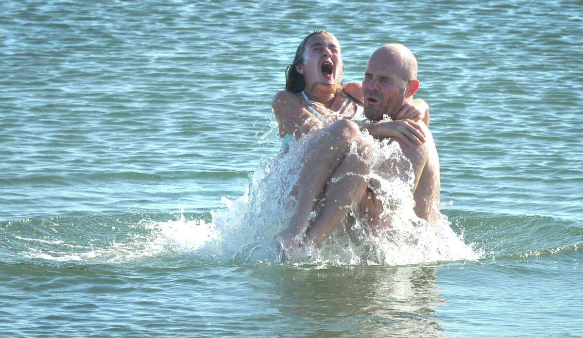 """Brian """"Ox"""" Lynch from Westport dunks family friend Lenora Lofrisco into a frigid Long Island Sound on New Year's Day at Compo Beach in Westport, during the 2017 Temple Israel 10th Anniversary Polar Bear Plunge. Around 100 peolple took the plunge and have raised so far 56 thousand dollars for many different charities. Including Interfaith Housing, Marfan Foundation, Autism Speaks, PanCan, Hole in the Wall Gang, Make a Wish, United Cerebral Palsy, in Westport Conn. on Sunday January 1, 2017"""