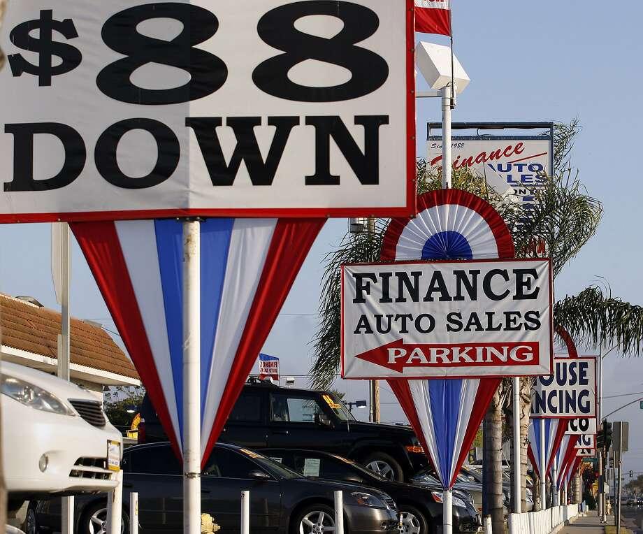 A used car lot in Hawthorne, Calif. (Gary Friedman/Los Angeles Times/TNS) Photo: Gary Friedman, TNS