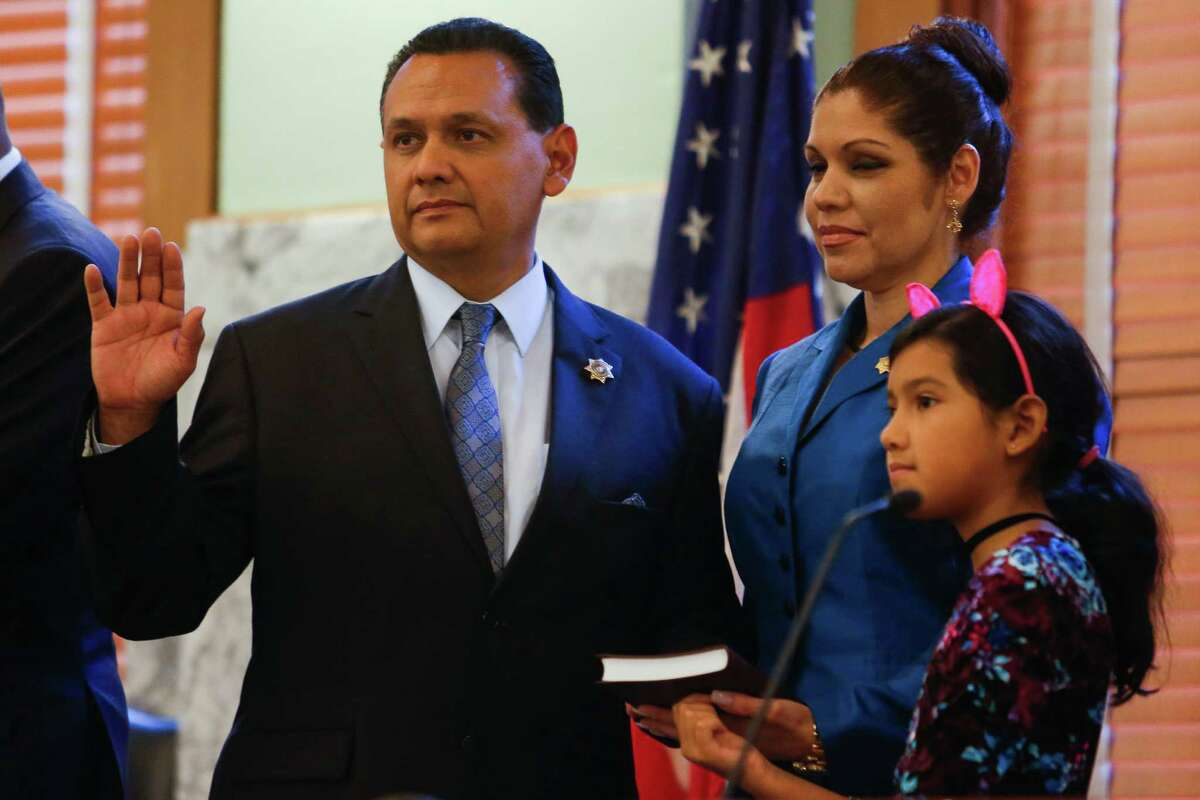 Harris County Sheriff Ed Gonzalez, left, is sworn in next to his families at the historic 1910 Harris County Courthouse Sunday, Jan. 1, 2017 in Houston.