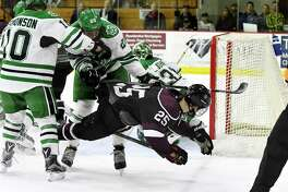 Union College forward Ryan Walker is tripped at the goal while trying to score against North Dakota on Saturday, Dec. 31, 2016, at Union College in Schenectady, N.Y. (Will Waldron/Times Union)