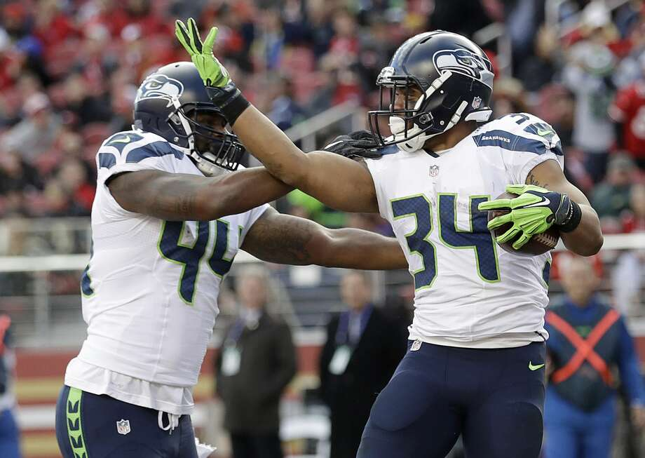 Seattle Seahawks running back Thomas Rawls (34) celebrates with fullback Marcel Reece (44) after scoring a touchdown during the first half of an NFL football game against the San Francisco 49ers in Santa Clara, Calif., Sunday, Jan. 1, 2017. (AP Photo/Marcio Jose Sanchez) Photo: Marcio Jose Sanchez/AP