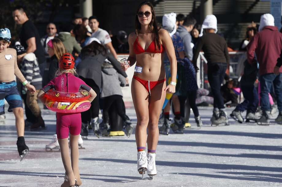Ava Van Natta skates in a bathing suit to celebrate the New Year at the annual Polar Bear Skate on the Union Square ice rink in San Francisco, Calif. on Sunday, Jan. 1, 2017. Photo: Paul Chinn, The Chronicle