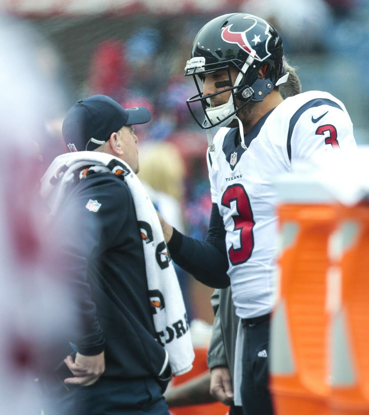 Houston Texans trainer Geoff Kaplan talks to quarterback Tom Savage after Savage left the game against the Tennessee Titans with an injury during the second quarter of an NFL football game at Nissan Stadium on Sunday, Jan. 1, 2017, in Nashville. ( Brett Coomer / Houston Chronicle )
