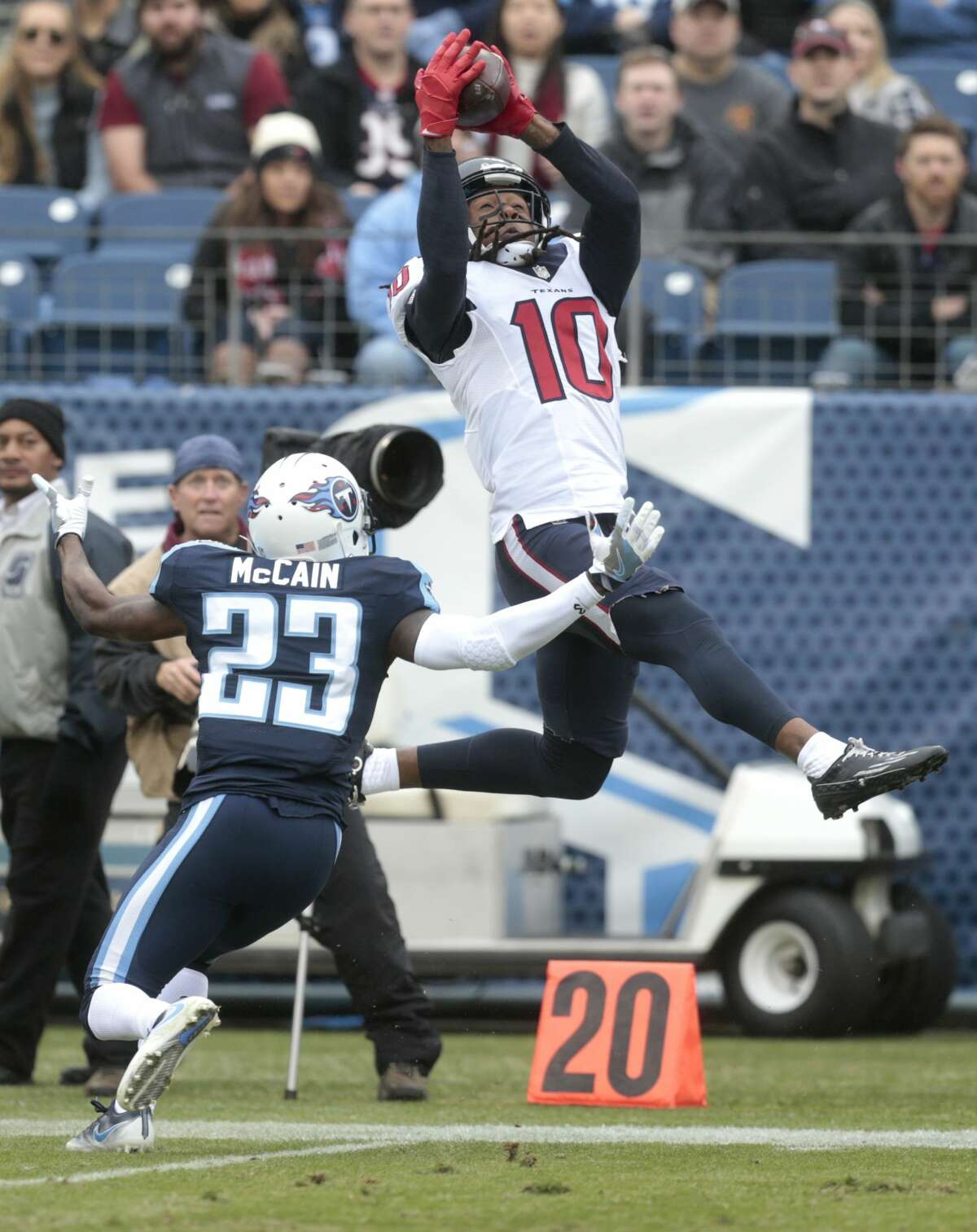 Houston Texans wide receiver DeAndre Hopkins (10) leaps over Tennessee Titans cornerback Brice McCain (23) in an attempt to make a catch, coming down out of bounds for an incomplete pass, during the second quarter of an NFL football game at Nissan Stadium on Sunday, Jan. 1, 2017, in Nashville. ( Brett Coomer / Houston Chronicle )