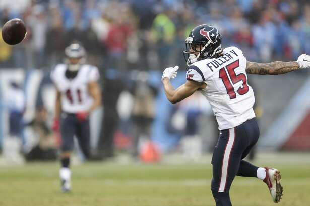 Houston Texans wide receiver Will Fuller (15) can't come down with a reception against the Tennessee Titans during the fourth quarter of an NFL football game at Nissan Stadium on Sunday, Jan. 1, 2017, in Nashville. ( Brett Coomer / Houston Chronicle )