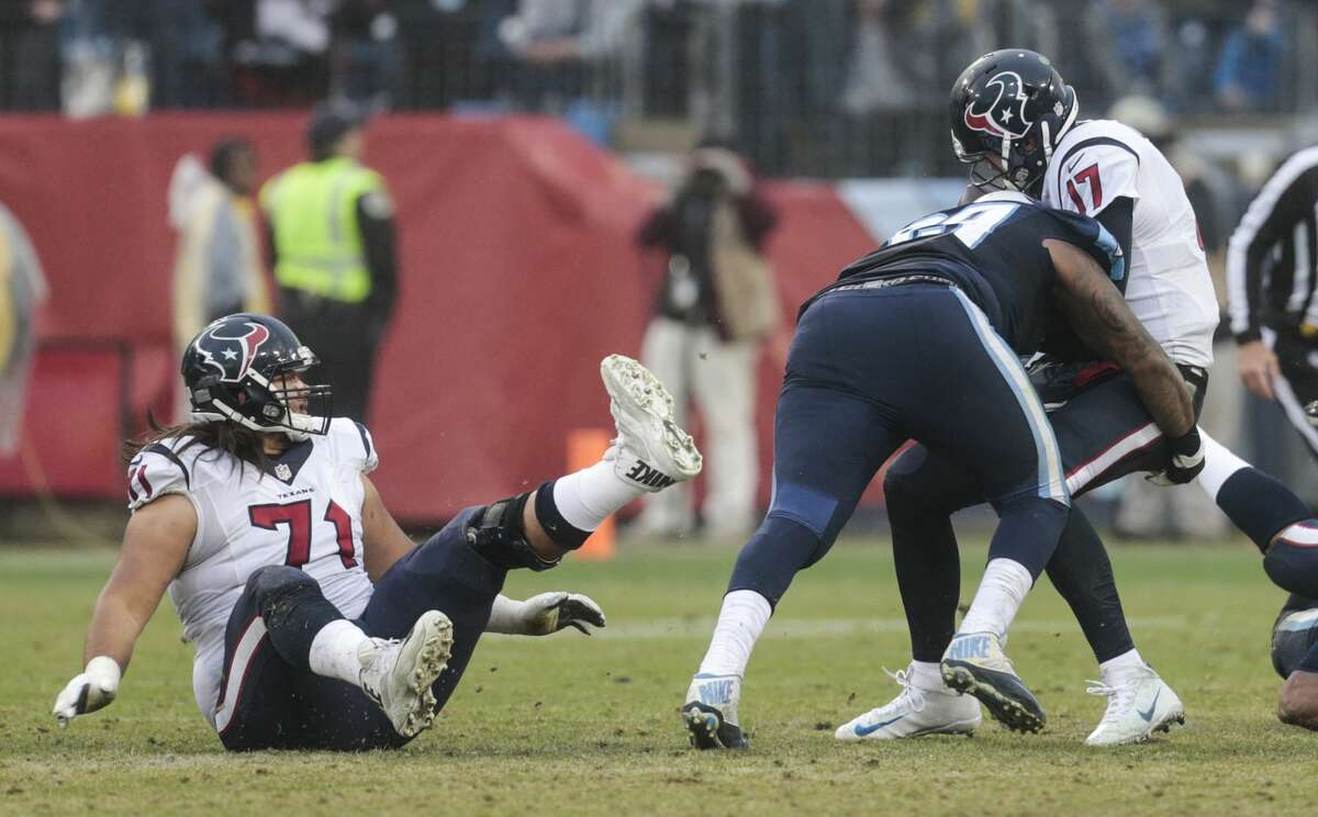 Houston Texans guard Xavier Su'a-Filo (71) falls to the turf as Tennessee Titans defensive end Jurrell Casey (99) sacks Texans quarterback Brock Osweiler during the fourth quarter of an NFL football game at Nissan Stadium on Sunday, Jan. 1, 2017, in Nashville. ( Brett Coomer / Houston Chronicle )