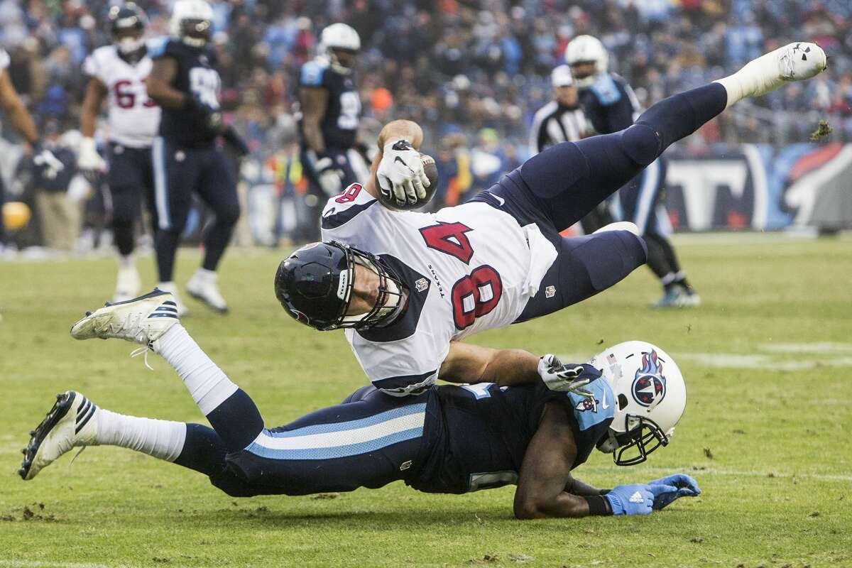 Houston Texans tight end Ryan Griffin (84) is tackled by Tennessee Titans strong safety Da'Norris Searcy (21) short of a first down during the fourth quarter of an NFL football game at Nissan Stadium on Sunday, Jan. 1, 2017, in Nashville. ( Brett Coomer / Houston Chronicle )